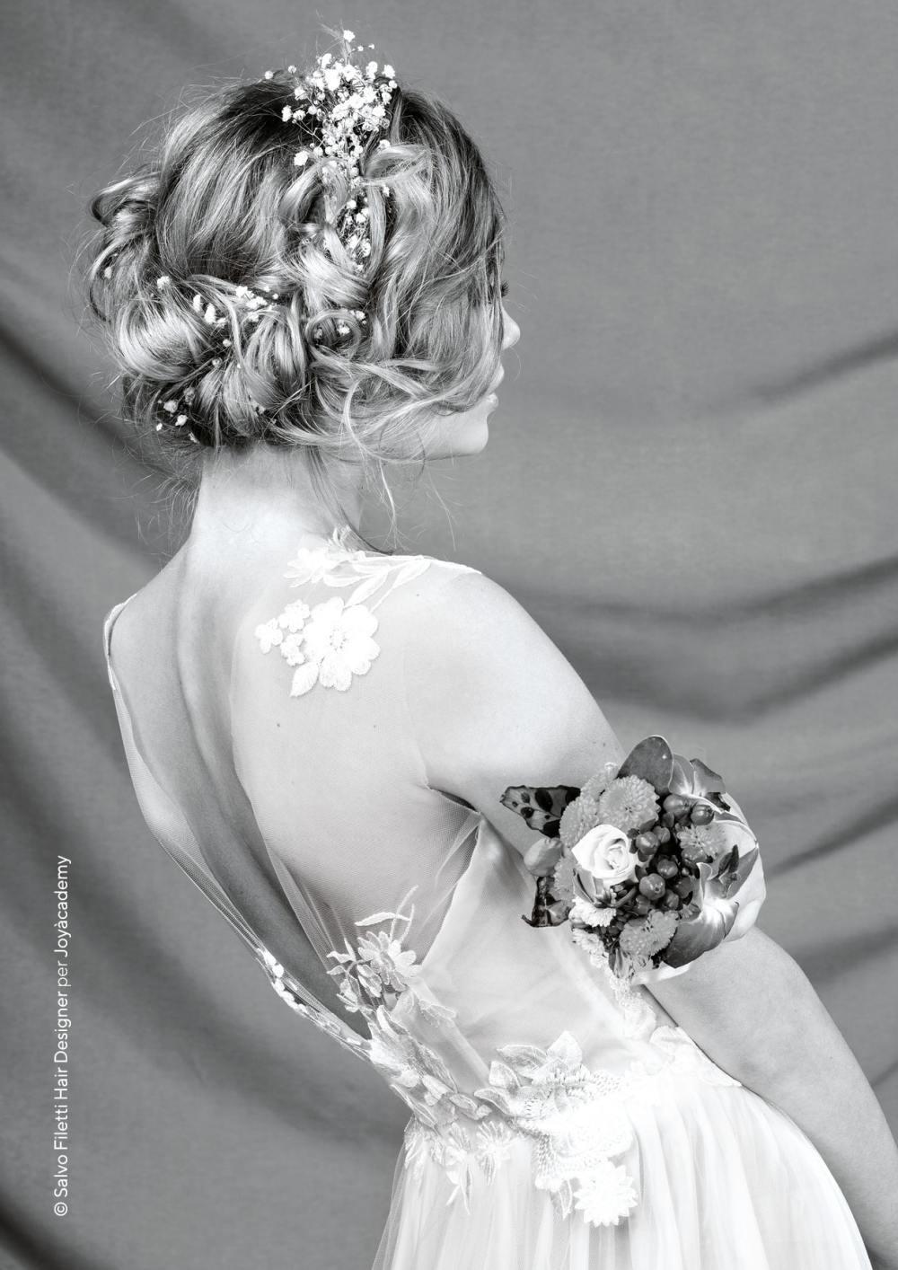Capelli raccolti sposa 2019